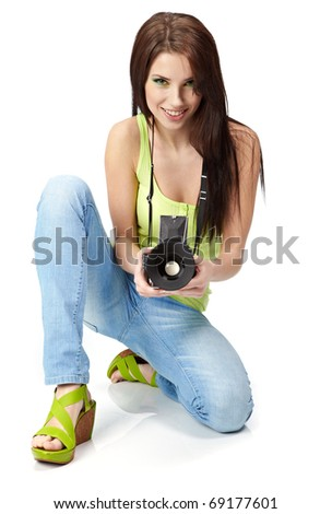 Beautiful young woman with camera. - stock photo