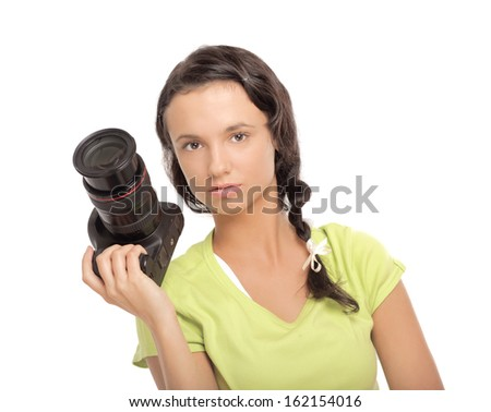 Beautiful young woman with camera.Isolated on white background - stock photo