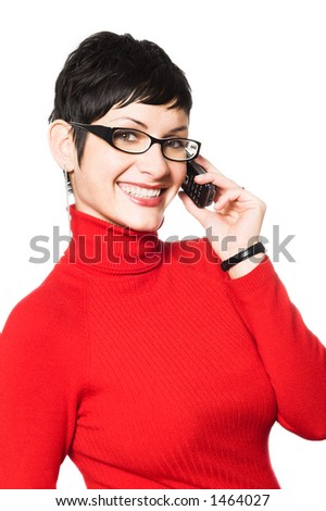Beautiful young woman with charming big green eyes is bearing modern glasses and receiving calls on a mobile phone. - stock photo
