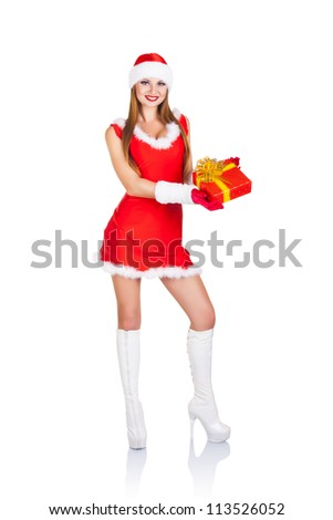 Beautiful young woman with Christmas present in a full-length isolated on white background