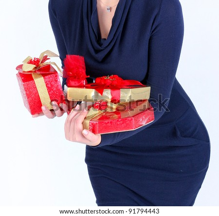 Beautiful young woman with christmas presents