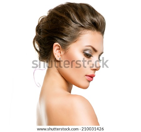 Beautiful Young Woman with Clean Fresh Skin close up isolated on white background. Beauty model Portrait. Beautiful Spa Woman profile portrait. Perfect Fresh Skin. Youth and Skin Care Concept  - stock photo