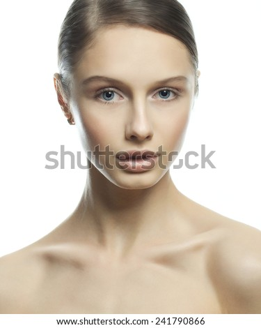 Beautiful Young Woman with Clean Fresh Skin close up isolated on white background. Beauty model Portrait. Beautiful Spa Woman profile portrait. Perfect Fresh Skin. Youth and Skin Care Concept. - stock photo