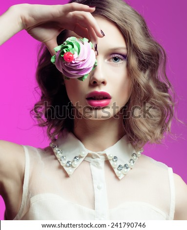 Beautiful Young Woman with Clean Fresh Skin, perfect make up and nails with cake over bright pink background. Fashion photo. - stock photo