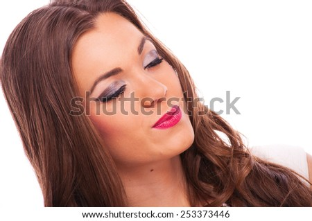 Beautiful young woman with closed eyes and makeup, on white background - stock photo