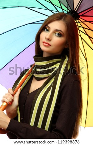 beautiful young woman with colorful umbrella, close up - stock photo