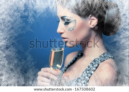 beautiful young woman with creative face art make up drinking Champagne - stock photo