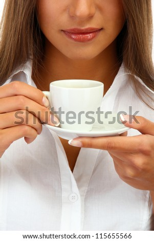 beautiful young woman with cup of coffee, close up
