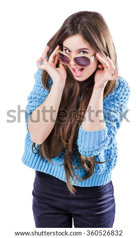 beautiful young woman with dark hair wearing a blue knitted sweater standing on a white background with the isolation points. Smiles. Keep glasses - stock photo