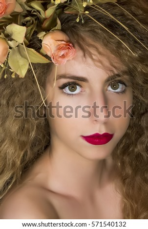 Beautiful young woman with delicate flowers in their hair. Soft focus