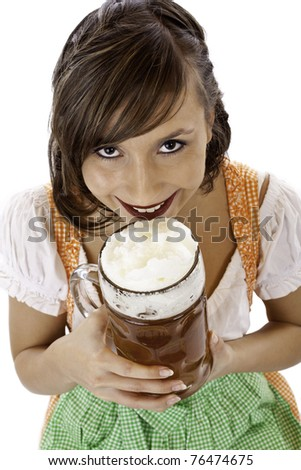 Beautiful young woman with dirndl drinks Oktoberfest beer stein. Isolated on white background. - stock photo