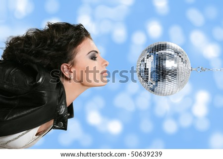 Beautiful young woman with disco ball - stock photo