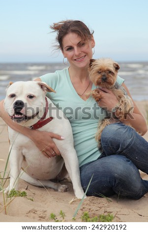 beautiful young woman with dogs - stock photo