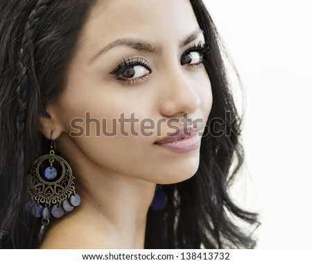 Beautiful young woman with exotic features. - stock photo