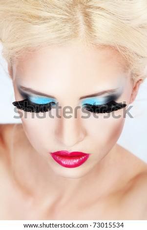 Beautiful young woman with fashion make-up - stock photo