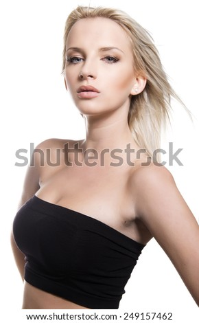 beautiful young woman with flawless skin and perfect make-up posing on isolated background - stock photo