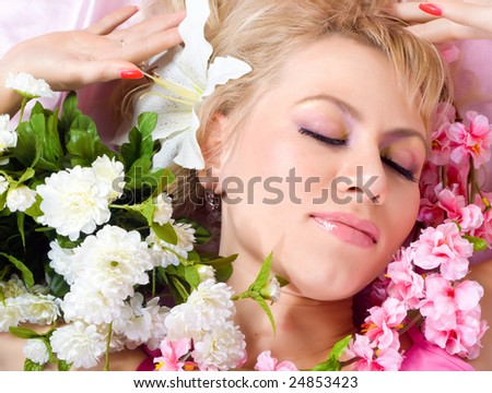 Beautiful young woman with flowers close-up