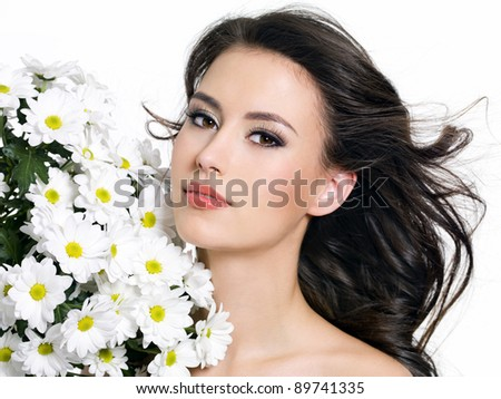 Beautiful young woman with flowers - white background