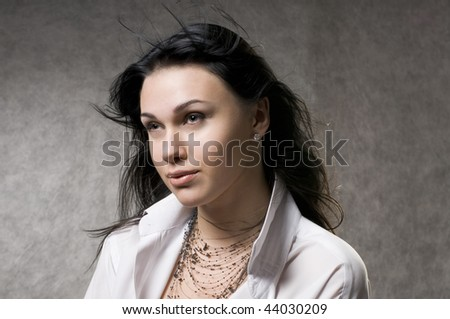 Beautiful young woman with fluttering long hair. - stock photo