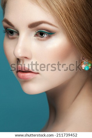 beautiful young woman with fresh make up and healthy skin on blue background. Trendy summer makeup - stock photo
