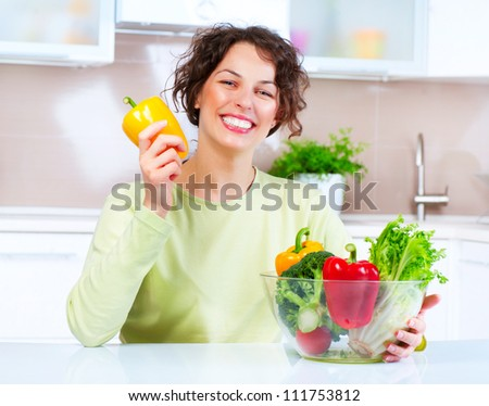 Beautiful Young Woman with Fresh Vegetables . Healthy food. Dieting concept .Diet. Vegetarian Food