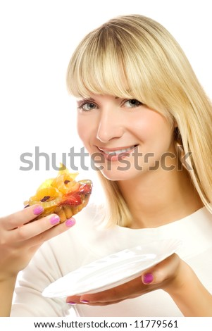 Beautiful young woman with fruit cake isolated on white background