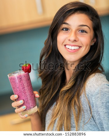 Beautiful Young Woman with Fruit smoothie  - stock photo