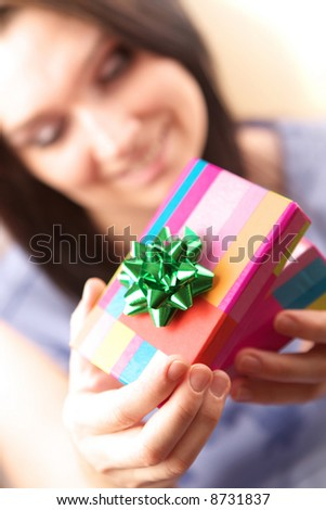 Beautiful young woman with gift box - stock photo