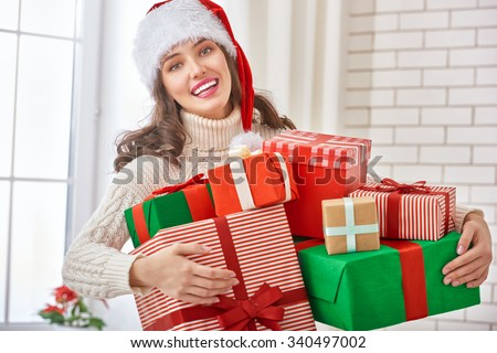 Beautiful young woman with gift boxes - stock photo