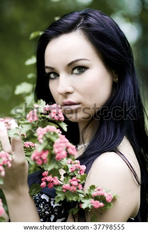 Beautiful young woman with green eyes - stock photo