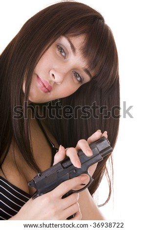 Beautiful young woman with gun. Isolated.