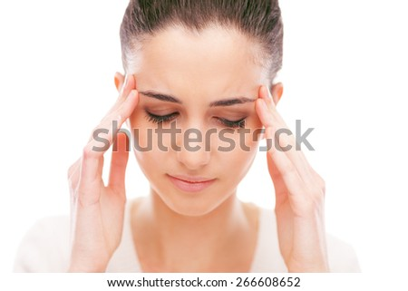 Beautiful young woman with headache touching her temples - stock photo
