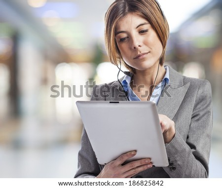 beautiful young woman with headphones and touching her tablet