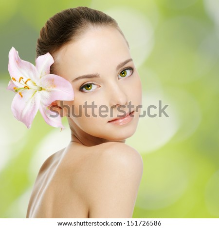 beautiful young woman with health skin and flower   - stock photo