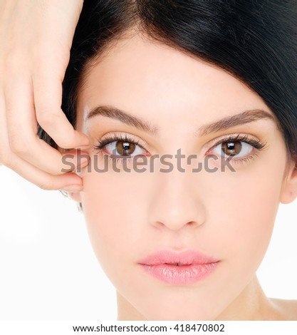 beautiful young woman with healthy clean skin on a face - stock photo