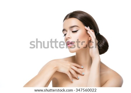 Beautiful young woman with healthy glowing skin. Beauty shot. Isolated over white background. Copy space. - stock photo