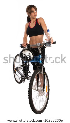 Beautiful young woman with her bike