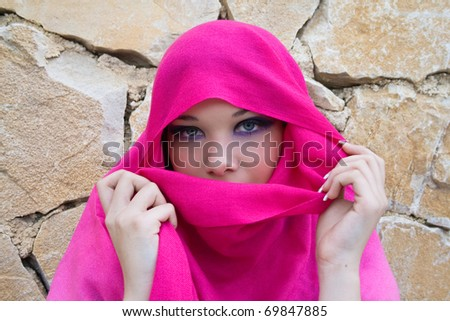 beautiful young woman with her veil around her face