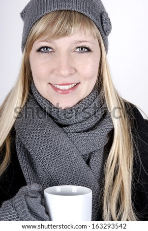 Beautiful young woman with hot beverage - stock photo
