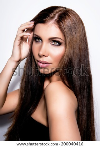 Beautiful young woman with long brown hair
