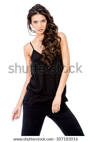 Beautiful young woman with long brunette hair posing over white background. Fashion style photo. - stock photo