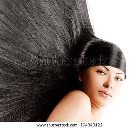 beautiful young woman with long natural healthy shiny long hair
