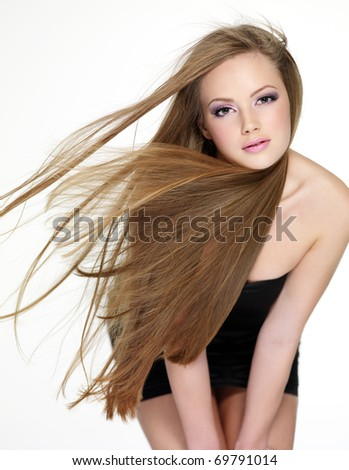 Beautiful young woman with  long straight hair, Portrait on white background - stock photo