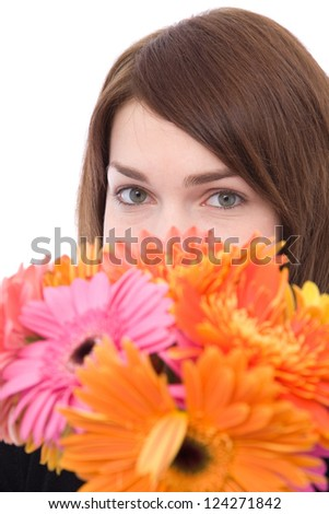 beautiful young woman with lots of colorful daisy flowers - stock photo