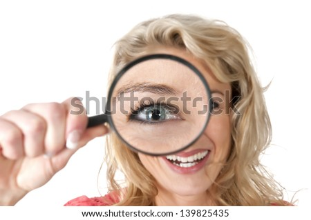 beautiful young woman with magnifying glass