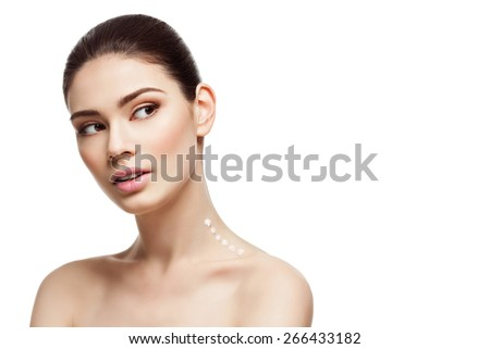 Beautiful young woman with moisturizing cream drops on neck. Beauty image. Copy space. Isolated over white background - stock photo