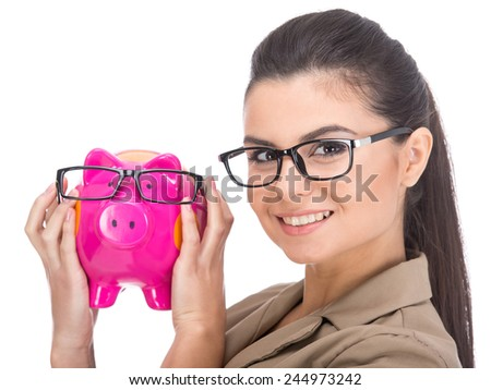Beautiful young woman with moneybox isolated on a white background. - stock photo