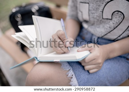 beautiful young woman with note at outdoor - stock photo
