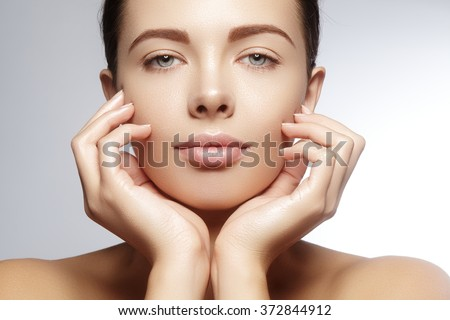 Beautiful young woman with perfect clean shiny skin, natural fashion makeup. Close-up woman, fresh spa look - stock photo