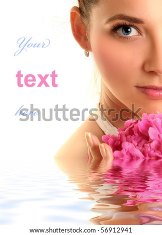beautiful young woman with pink flower isolated on white - stock photo